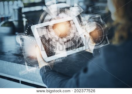Woman using tablet computer with digital business hologram. Technology concept. Double exposure
