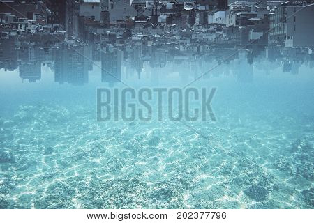Abstract upside-down city and water ocean sea background with copy space. Creativity abstraction and innovation concept