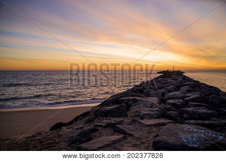 Sunrise over the Atlantic Ocean from a jetty