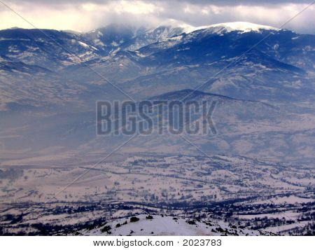 View from the top of Vodno mountain with a winter storm coming in - looking away from Skopje Macedonia. Taken in January 2005. poster