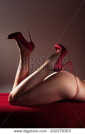 woman wearing red heels and red underwear got her heel caught on a thong