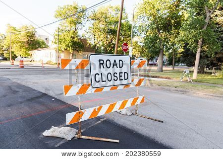 Residential street blocked by Road Closed construction sign.