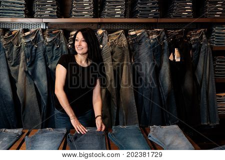 jeans store woman shop assistant at work