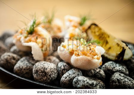 Tartare of salmon on a crab shell patch served on cold stones