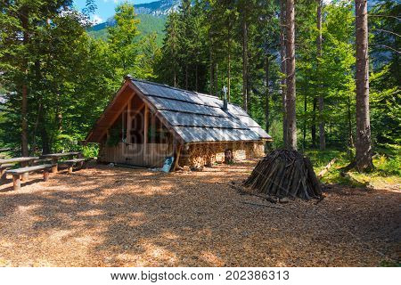 Mountain cabin, hut, Charcoal Burner House in European Alps, located in Robanov kot, Slovenia, popular hiking and climbing place with picturescue view