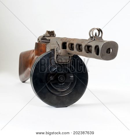 submachine gun ppsh-41 on a light background. The view from the front.