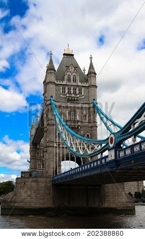 Tower Bridge in London in a beautiful summer day, England, United Kingdom It is a combined bascule and suspension bridge built between 1886 and 1894.