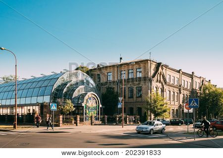 Brest, Belarus - June 6, 2017: Winter Garden And Brest State University Named After A. S. Pushkin At Adam Mickiewicz Street In Sunny Summer Day. Former Gymnasium For Men.
