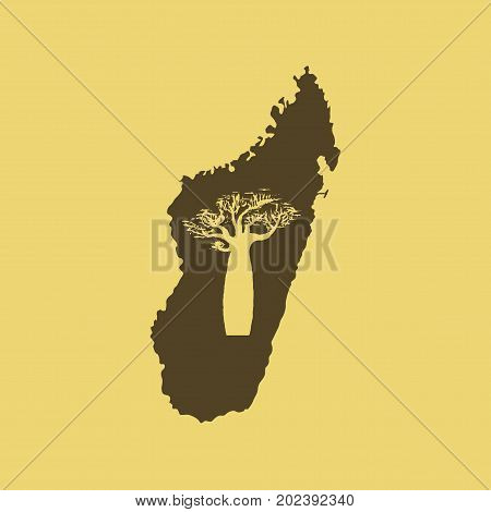 Vector silhouette of brown Madagascar with orange baobab silhouette inside.