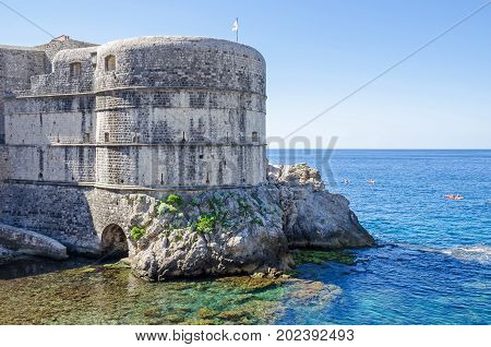 Fort Bokar the key point in the defense of the Pila Gate the western fortified entrance of the Dubrovnik's Old City one of the most prominent tourist destinations in the Mediterranean Sea with the Adriatic Sea and tourists boats.