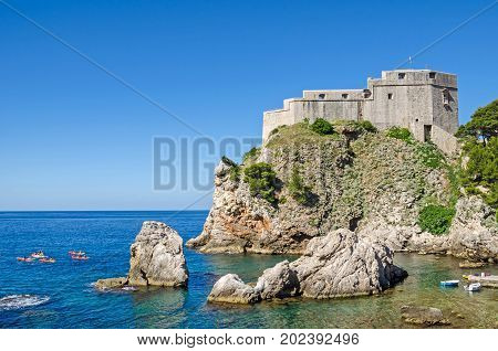 Fort Lovrijenac or St. Lawrence Fortress often called Dubrovnik's Gibraltar a fortress and theater outside the western wall of the old city of Dubrovnik in Croatia with the Adriatic Sea and tourists boats.
