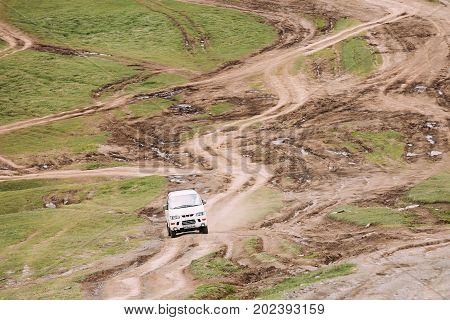 Stepantsminda Gergeti, Georgia - May 23, 2016: Mitsubishi Delica Space Gear on country road in summer mountains landscape. Delica is a range of trucks and multi-purpose vehicles produced by Mitsubishi Motors.