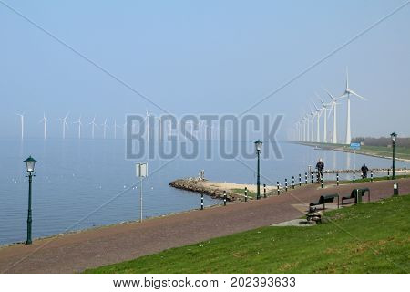 Windmills in the water from the Ijsselmeer in the Neterlands