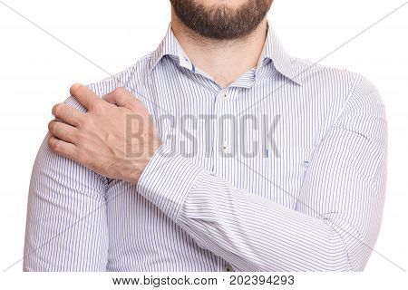 A man hurts his shoulder on white background isolation