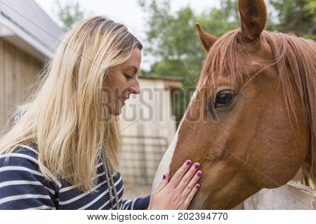 A woman long hair with beautiful horse