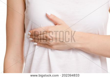 Female hand hurts chest on white background isolation