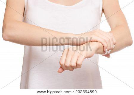Female hand hurts wrist hand on white background isolation