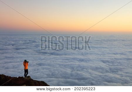Young girl photographer on Pico Volcano (2351m), Pico Island, Azores, Portugal, Europe