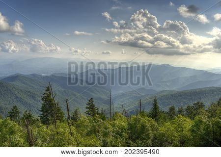Sunbeams shine on the ancient land in the Appalachian Mountains of Great Smoky Mountains National Park from Clingman's Dome in North Carolina USA.