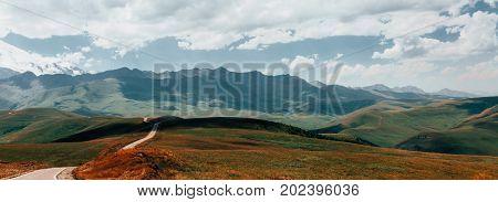 Panorama Road Leading To Mount Elbrus In Summer. North Caucasus Russia