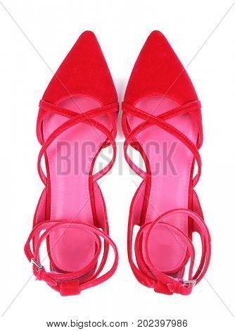 Pair of classic female shoes with crisscross straps isolated on white