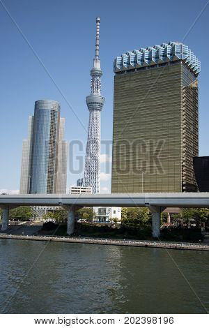 Tokyo Japan April 242017 Tokyo skytree the highest tower in Japan with blue sky background and Sumida river as foreground