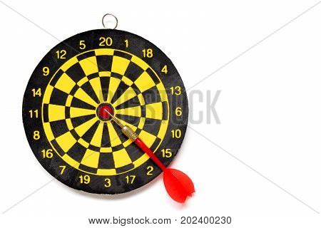 Yellow and black color dartboard with number and dart on white background