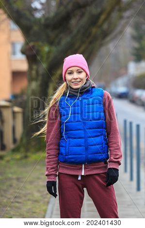 Woman Wearing Warm Sportswear Relaxing After Exercising