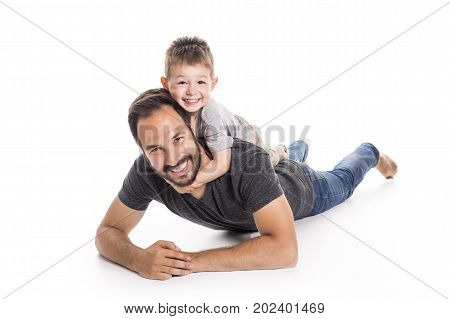 A Father and son having fun over white background