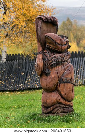 ESSO VILLAGE KAMCHATKA RUSSIA - SEP 18 2013: Traditional wood carving - Kutkh - embodiment of spirit of Raven traditionally revered by various indigenous peoples. Bystrinsky Ethnographic Museum.