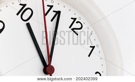 Closeup white clock ticking showing ten hours. Time concept.
