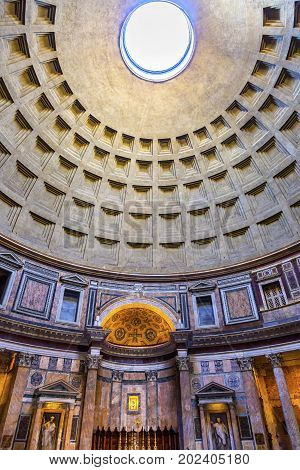 ROME, ITALY - January 19, 2017 Dome Pillars Oculus Altar Pantheon Rome Italy Rebuilt by Hadrian in 118 to 125 AD Became oldest Roman church in 609 AD. Oculus hole provides only light.