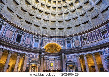 ROME, ITALY - January 19, 2017 Dome Pillars Altar Pantheon Rome Italy Rebuilt by Hadrian in 118 to 125 ADthe Second Century Became oldest Roman church in 609 AD. Oculus hole provides only light.