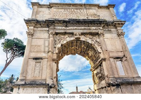 Titus Arch Roman Forum Rome Italy. Stone arch was erected in 81 AD in honor of Emperor Vespasian and his son Titus for conqueiring Jerusalem and destroying the Jewish temple in 70 AD. The Colosseum and the Arch were funded by the riches collected in Jerus