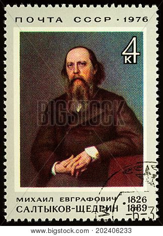 Moscow Russia - August 31 2017: A stamp printed in USSR (Russia) shows portrait of Russian writer Saltykov-Shchedrin devoted to the 150th Birth Anniversary of Saltykov-Shchedrin circa 1976