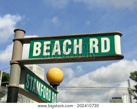 Beach road and stamford green roadsign in Singapore
