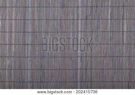 Bamboo napkin mat texture. Wood stripes background. Space for food. Cafe and restaurant decoration. Kitchen ideas. Background old natural straw grunge texture