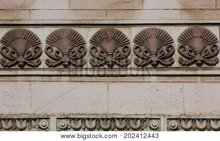 Old brown architecture detail with spikelets of wheat