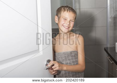 A Happy young boy in the bathroom