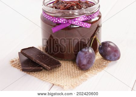 Plum Marmalade Or Jam In Glass Jar, Fruits And Chocolate, Sweet Dessert Concept