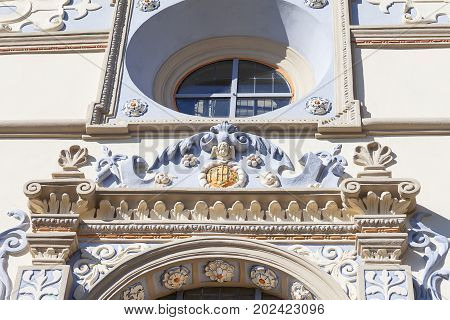 Renaissance Parish Church of St. John the Baptist and St. Bartholomew details of facade Kazimierz Dolny Poland. It was founded by King Casimir the Great around 1325.