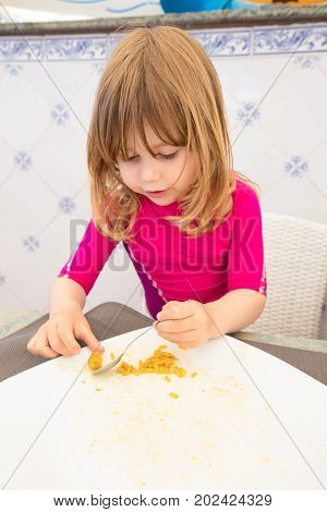 Child Eating And Finishing Big Plate Of Paella