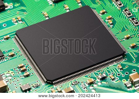 Macro view of CPU or chip on green printed circuit board PCB
