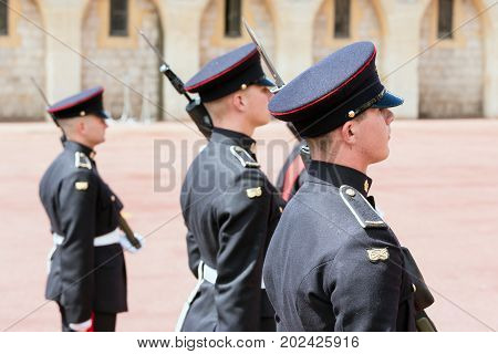 WINDSOR ENGLAND - JUNE 09 2017: Changing guard ceremony with soldiers armed with rifles and bayonet in Windsor Castle country house queen of England
