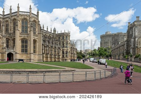 WINDSOR ENGLAND - JUNE 09 2017: People visiting Windsor Castle with St George's chapel. Windsor Castle is the family home to British kings and queens for over 1000 years.