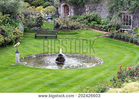 Courtyard garden of Windsor Castle near London England poster