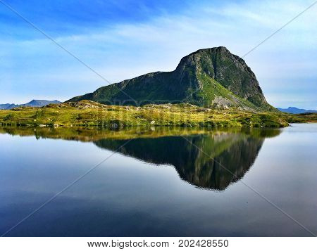 Symmetry reflection in Gimsoysand, Lofoten islands, Norway