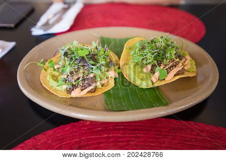 Two Tacos Del Pastor In Ceramic Dish