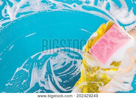 Cleaning conept hand cleaning glass window pane with detergent and wipe or sponge