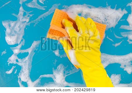 Cleaning concept hand with a rag cleans the surface